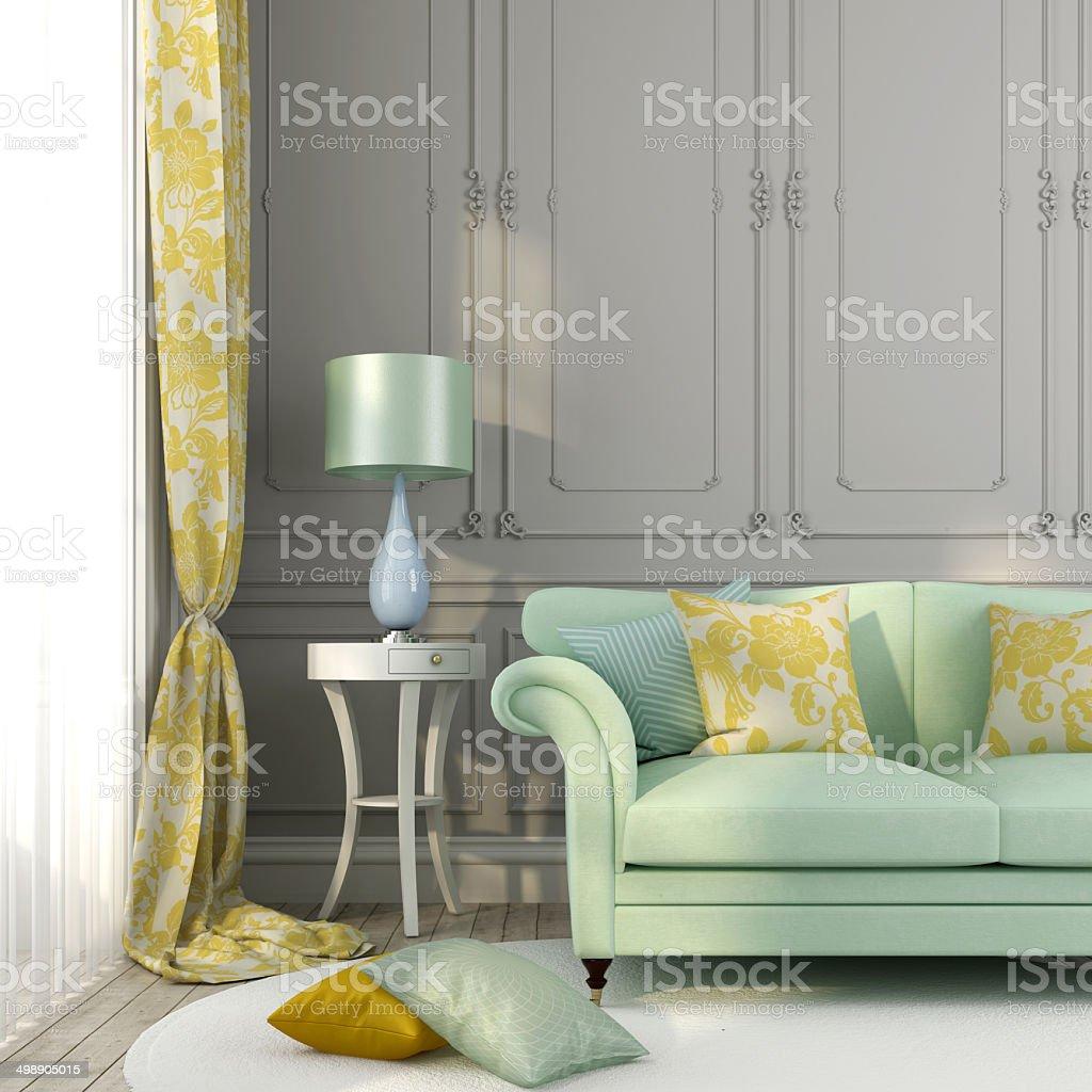 Green sofa yellow pillows stock photo