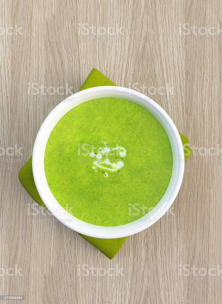 Green soup in bowl stock photo
