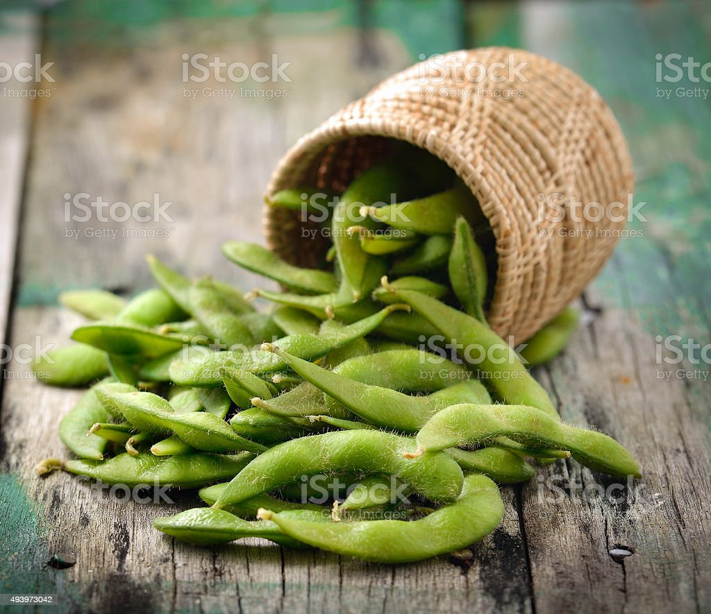 green soy beans in the basket on wooden stock photo