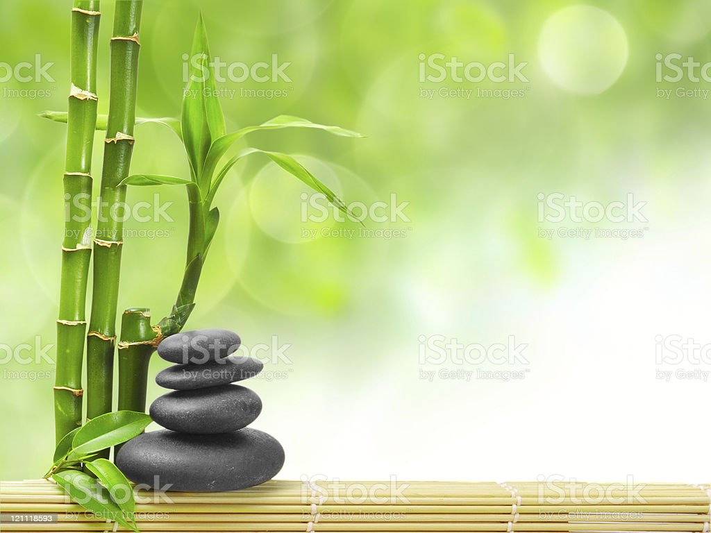 Green spa concept with massage stones stock photo
