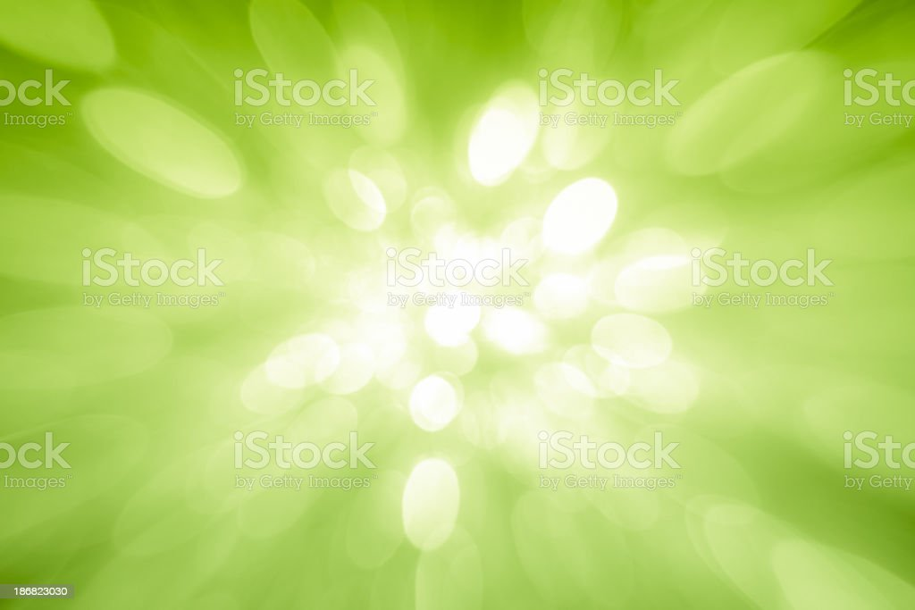 Green sparkles coming from the center stock photo