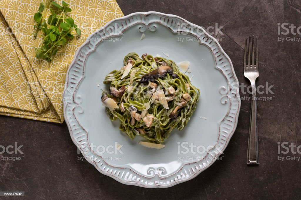 Green Spinach Pasta Tagliatelle with Bacon, Brown Shimeji Mushrooms and Parmesan Cheese stock photo