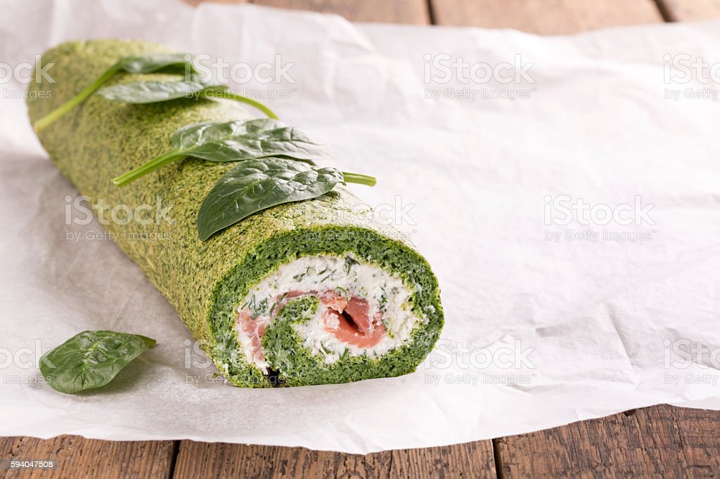 Green spinach roll with soft cheese and salmon stock photo