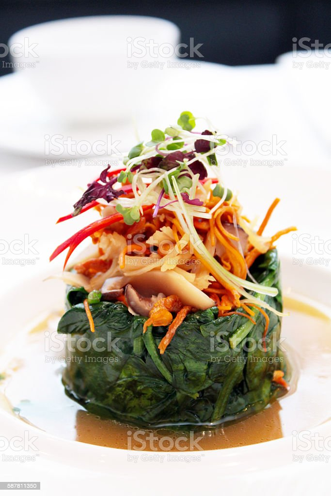 Green Spinach Soup with Mushrooms - Pan Asian Food stock photo