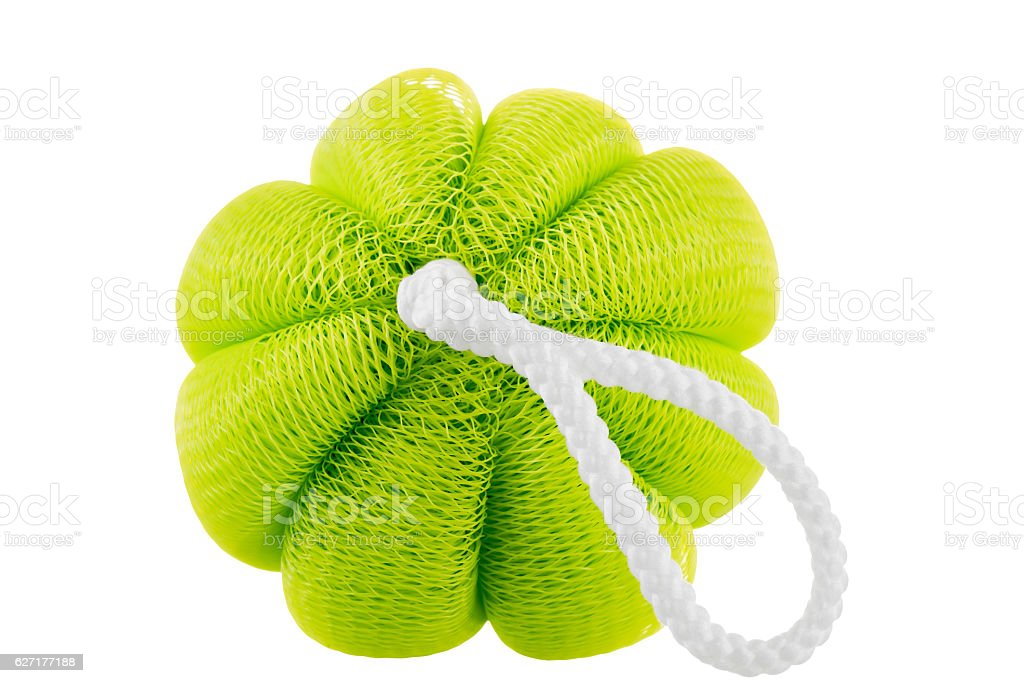 Green sponge close up on a white background isolated stock photo