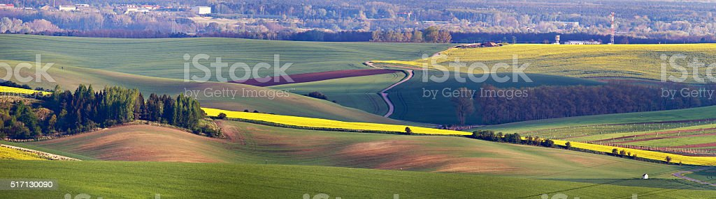 Green spring hills. Arable lands in Czech Moravia stock photo