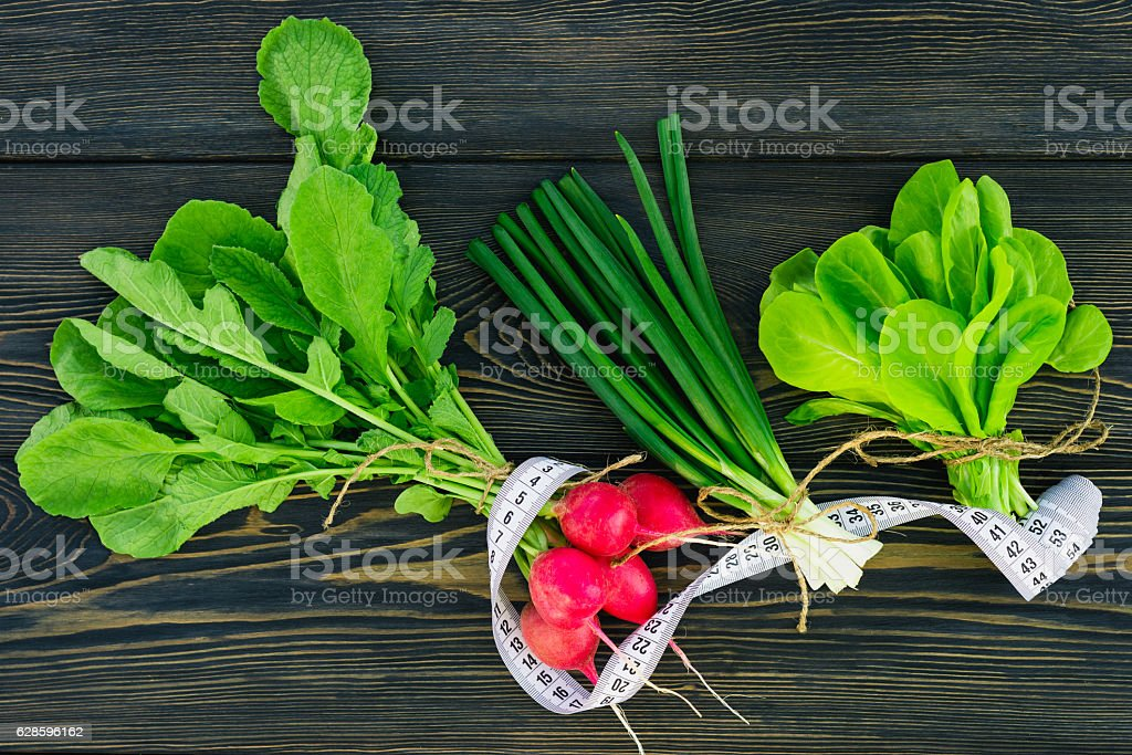 green spring vegetables and herbs stock photo