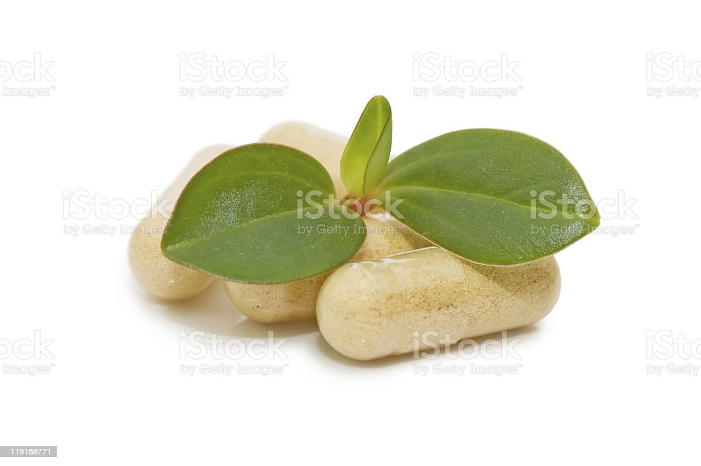 Green sprout from pills isolated on white royalty-free stock photo