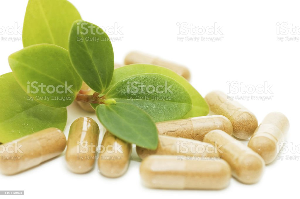 Green sprout from pills stock photo
