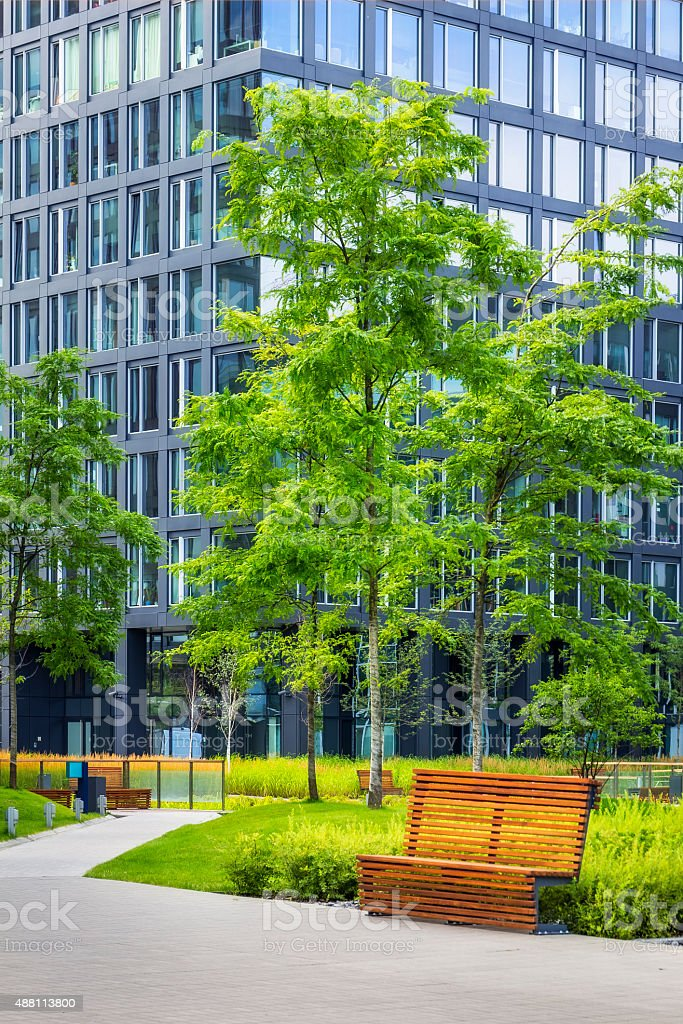 Green square in front of office building stock photo