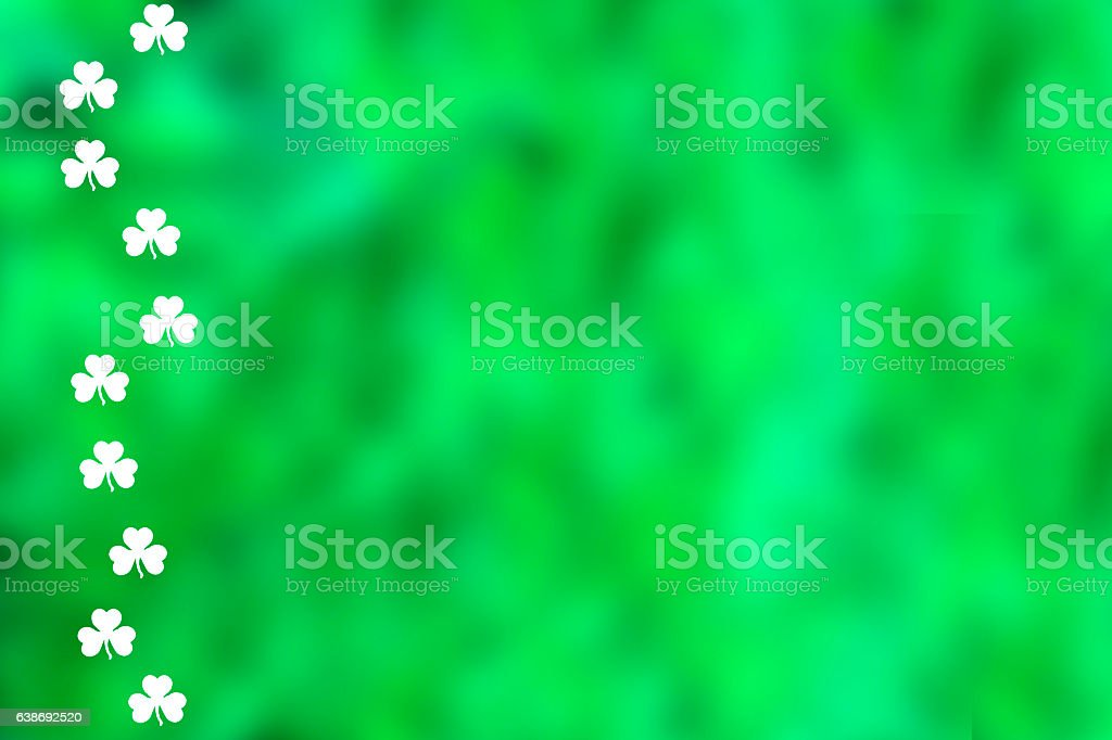 Green St. Patrick's Day background with white clovers stock photo
