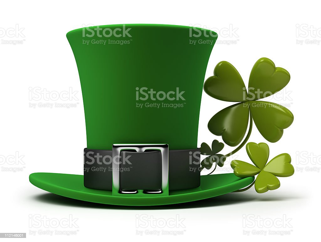 Green St. Patrick's day hat and four leaf clovers stock photo