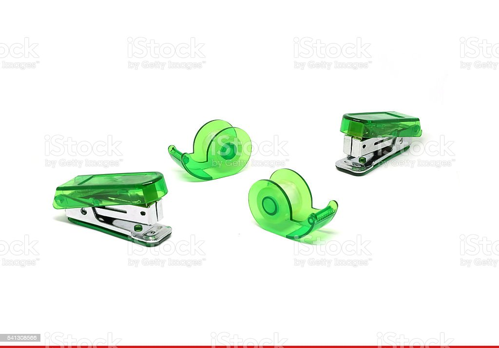 Green Stapler and Green Scotch tape stock photo