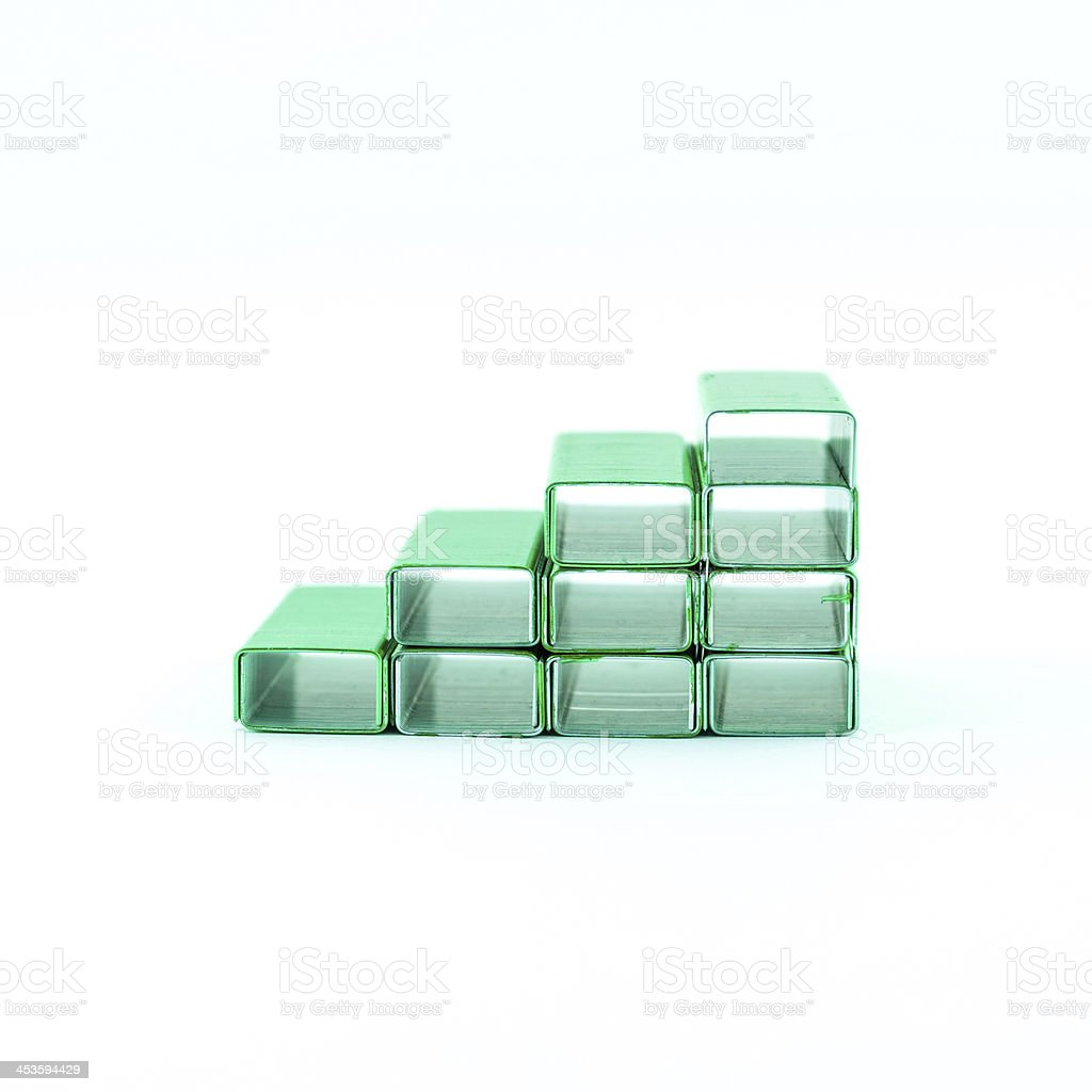 Green staples in box royalty-free stock photo