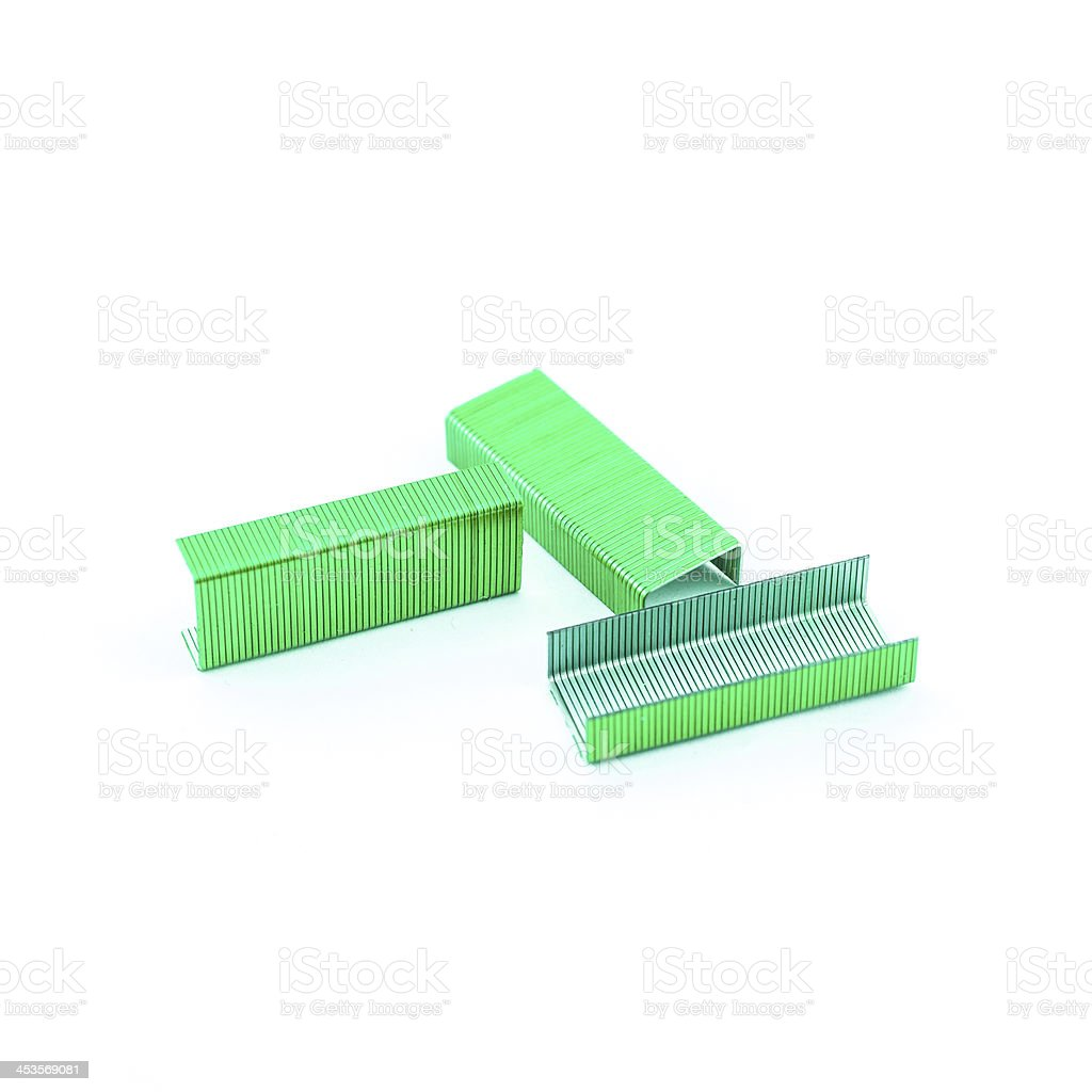 Green Staples isolated royalty-free stock photo
