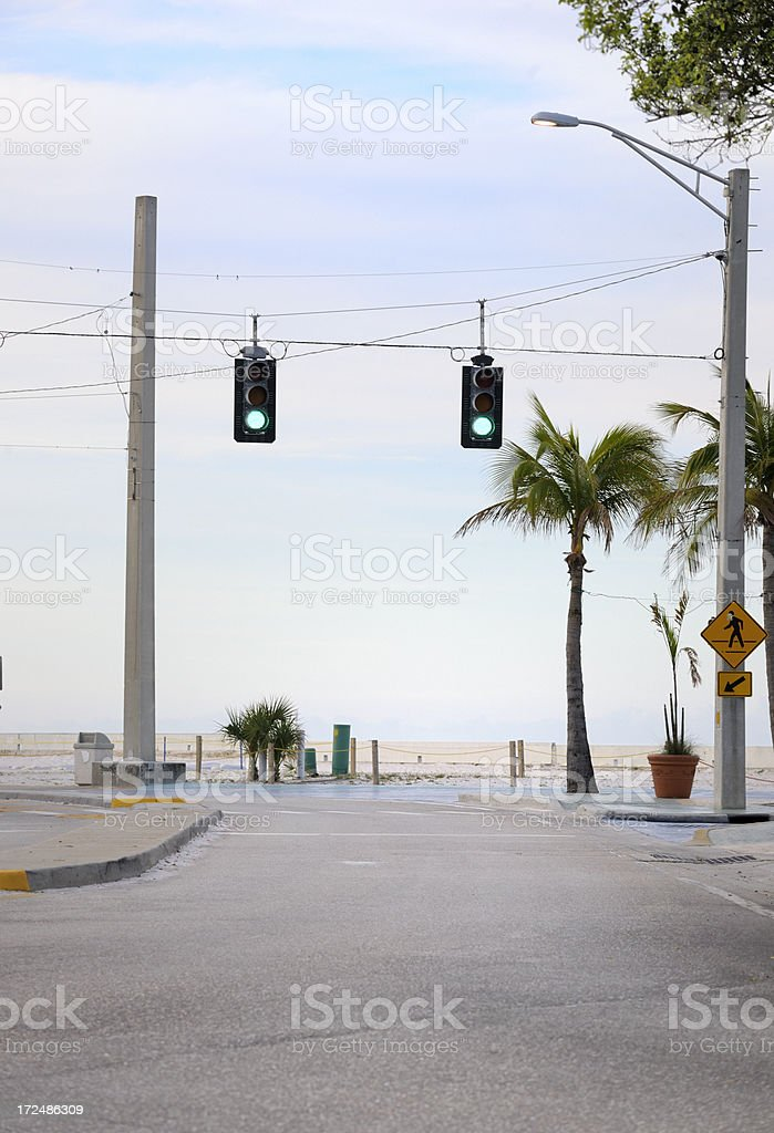 green stoplight at road intersection royalty-free stock photo