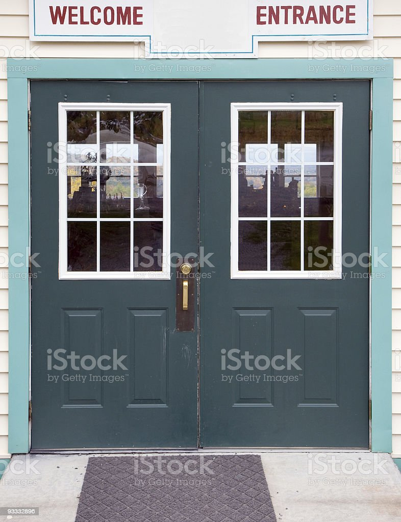 Green store entrance doors royalty-free stock photo