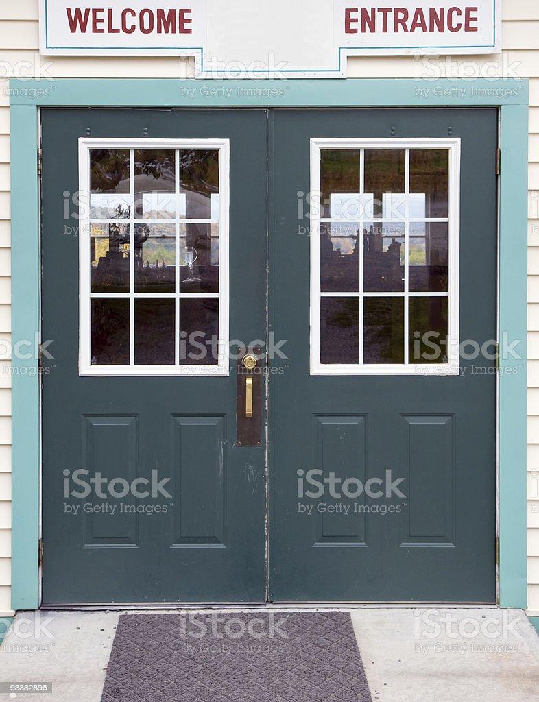Green store entrance doors stock photo
