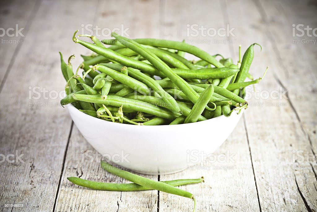 green string beans in a bowl stock photo