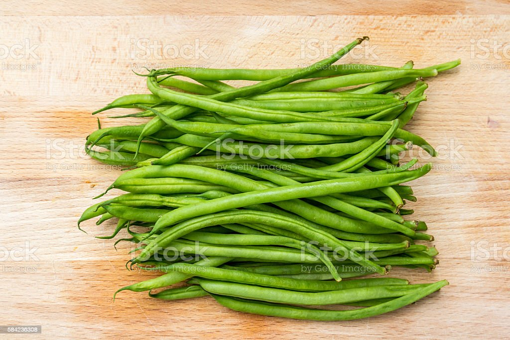 green string beans ready for the pot stock photo