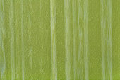 Green striped imitation leather background texture