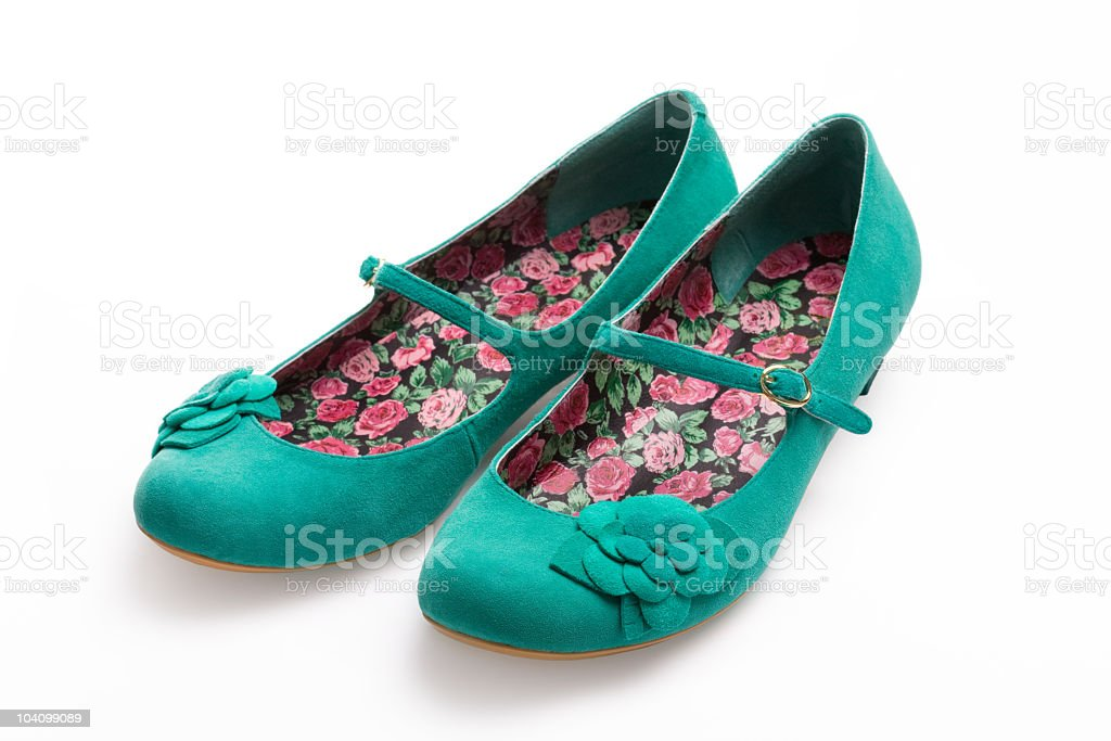 Green suede shoes with a floral print on the inside stock photo