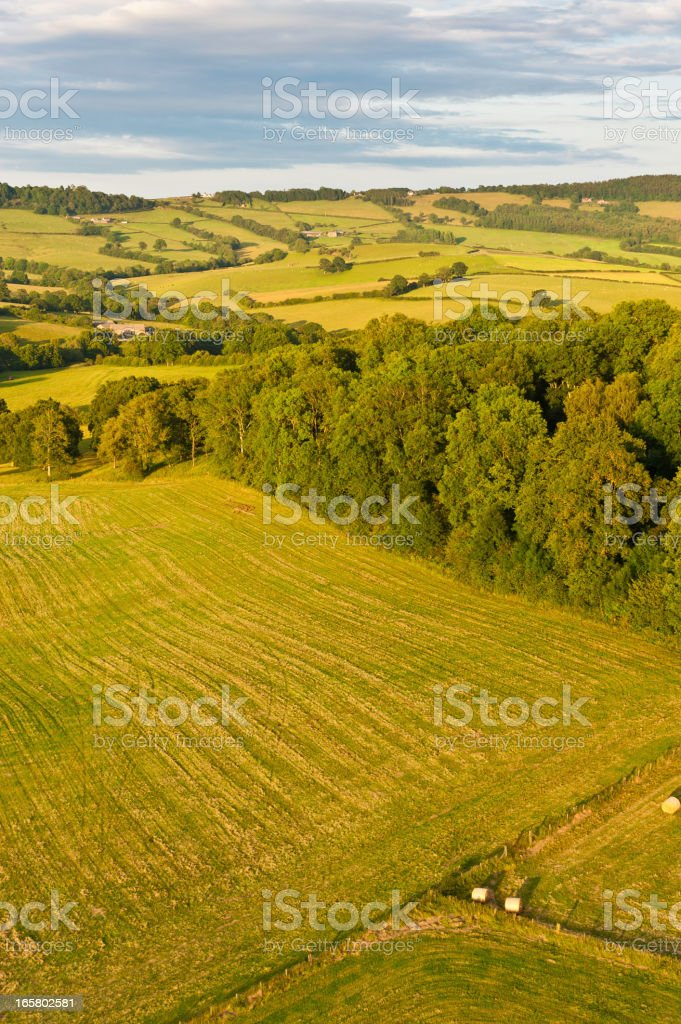 Green summer farmland rolling hills aerial landscape royalty-free stock photo