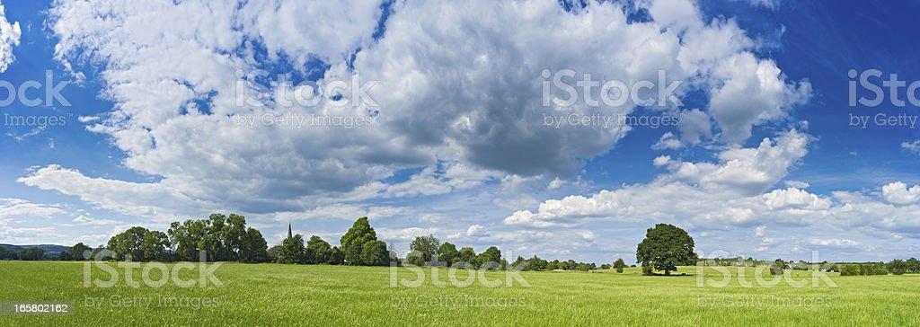 Green summer meadow big sky country farmland panorama royalty-free stock photo