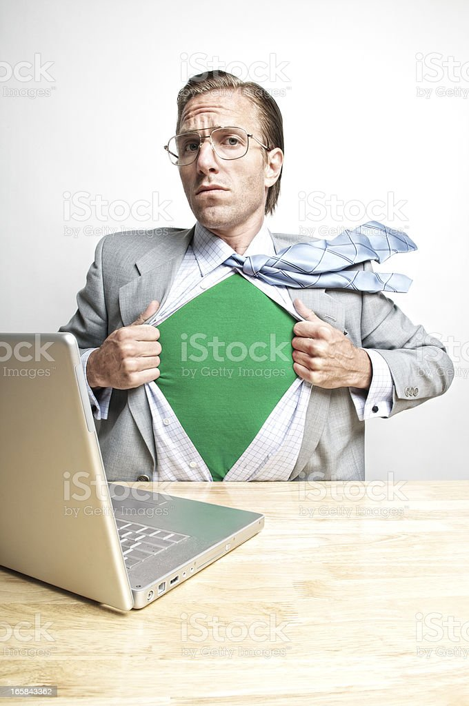 Green Superhero Emerges from His Desk royalty-free stock photo