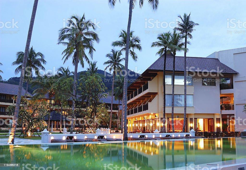 Green swimming pool near open-air restaurant, Koh Chang, Thailand stock photo
