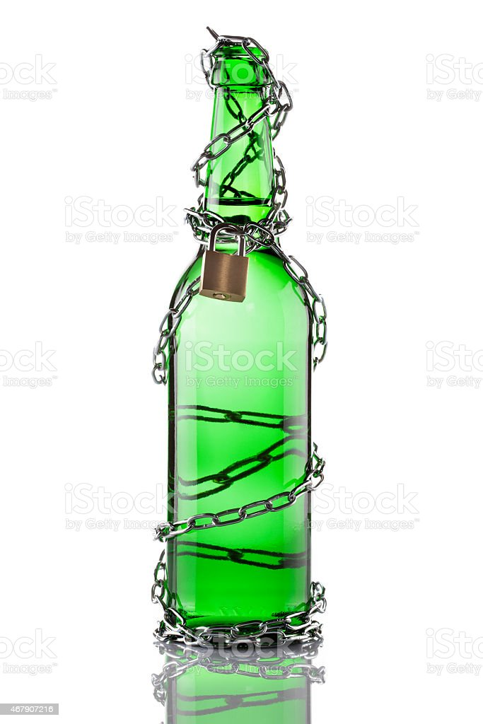 Green swing top beer bottle in chains stock photo