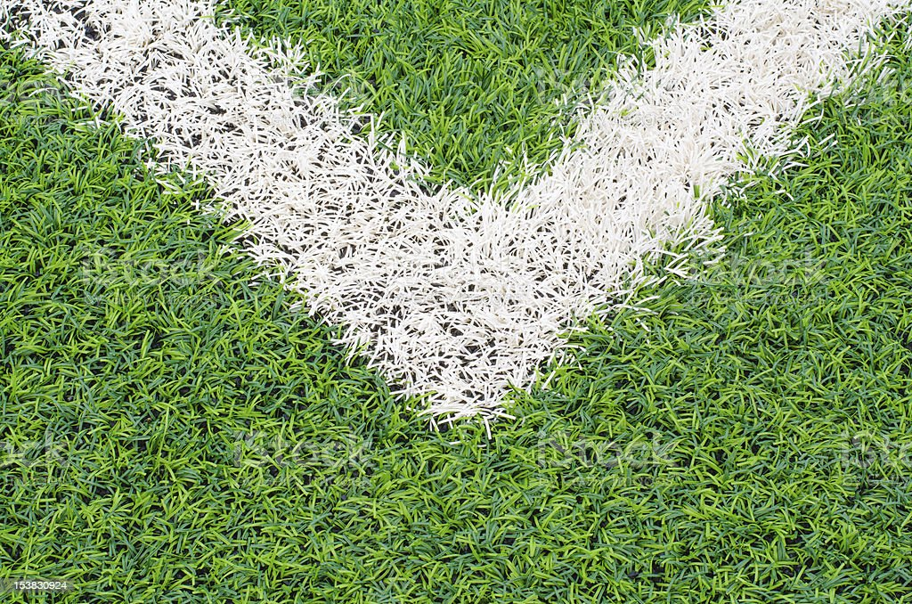 green synthetic grass sports field with white line royalty-free stock photo