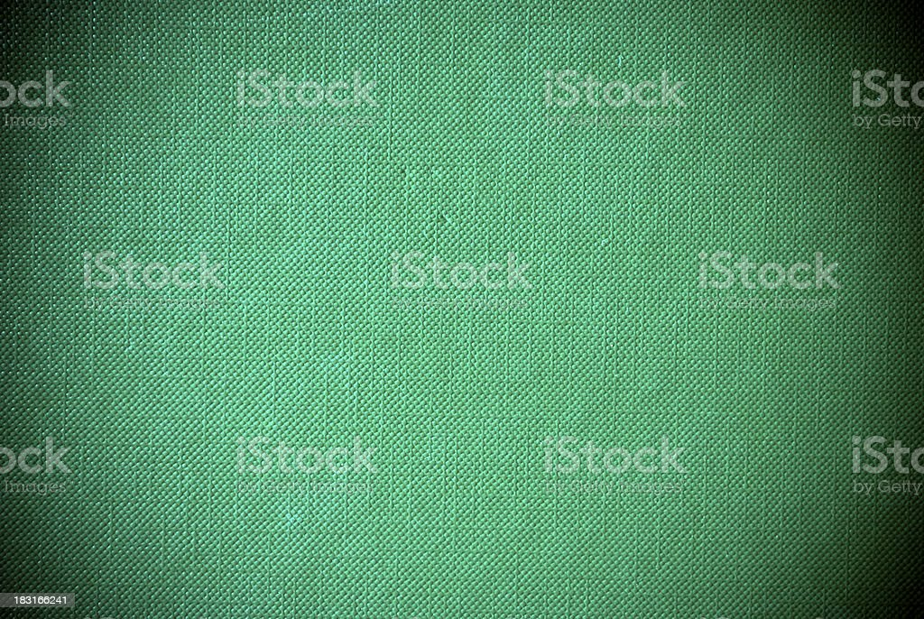 Green synthetic plastic grained material background or texture royalty-free stock photo