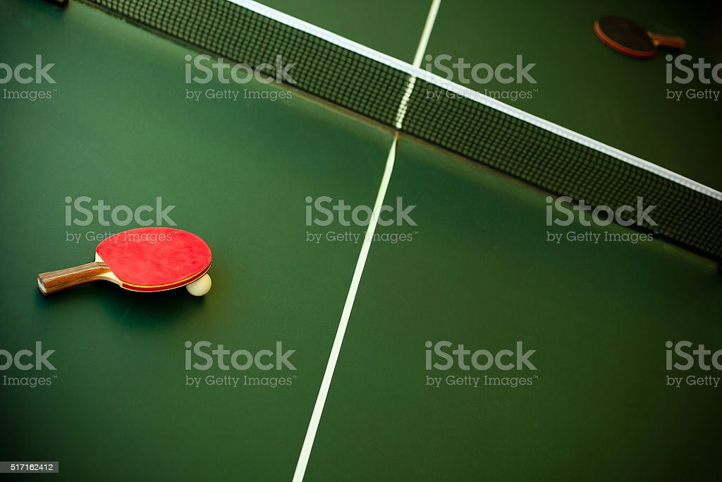 Green Table Tennis with racketsand ball stock photo