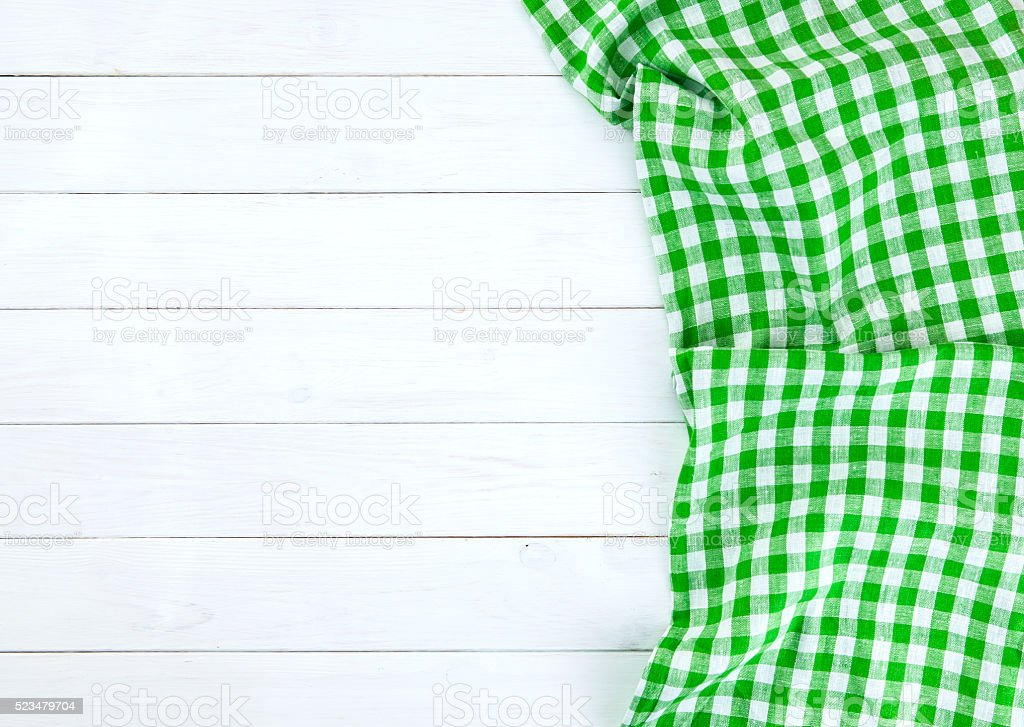 Green tablecloth on white wood table stock photo