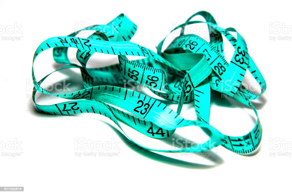 Green tape measure on white background stock photo