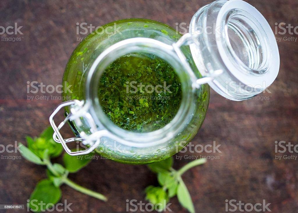 Green tasty herb sauce marinade from oregano, parsley, oil stock photo