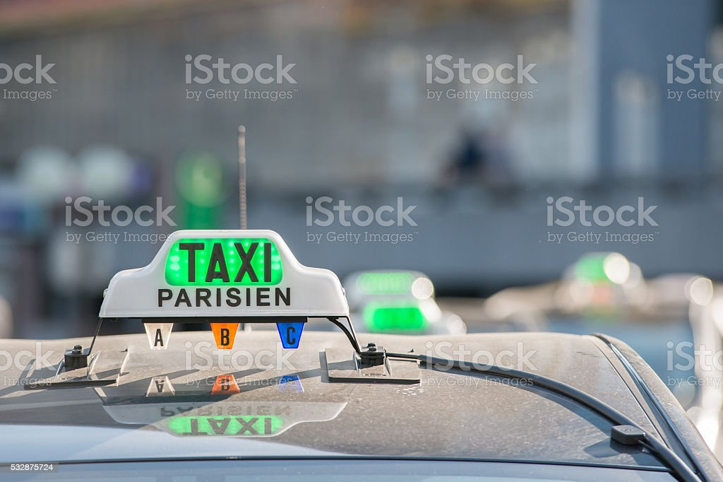 Green taxi sign in Paris, France stock photo
