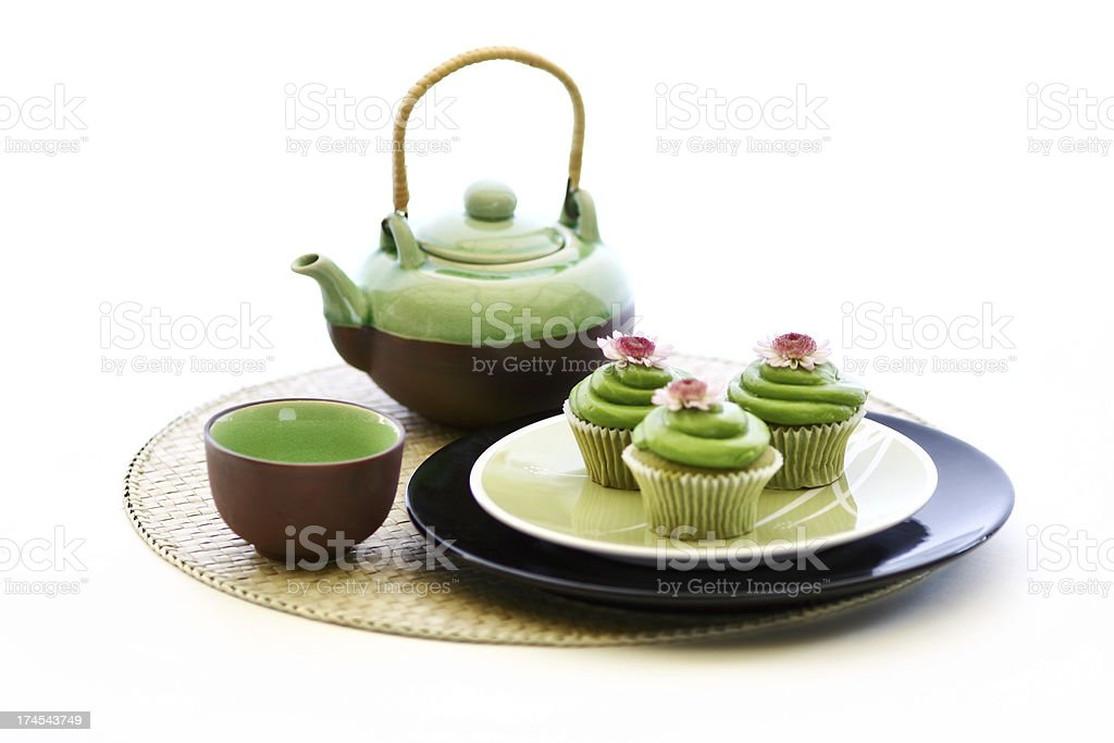 green tea and cupcake wtih teapot stock photo