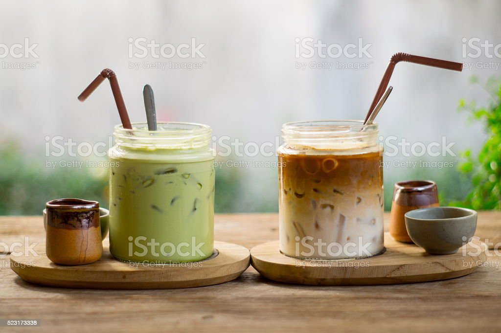 Green tea and iced coffee on wood table. stock photo