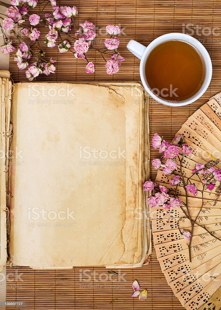 Green tea and old book royalty-free stock photo