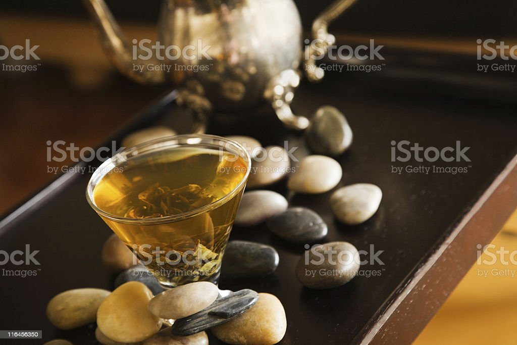 Green tea and pebble stones royalty-free stock photo