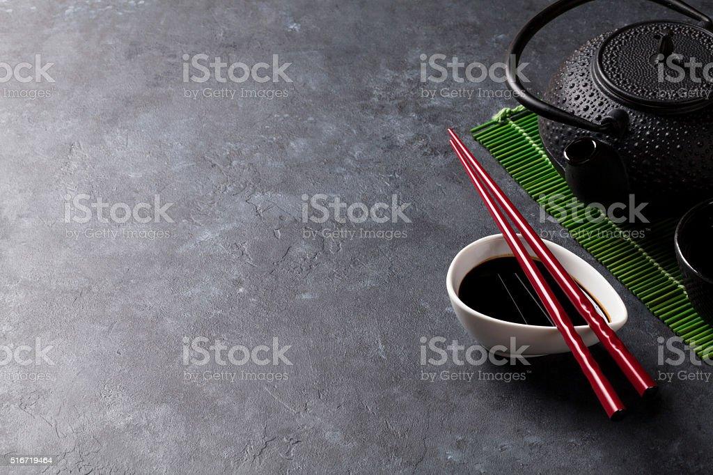 Green tea and sushi chopsticks stock photo