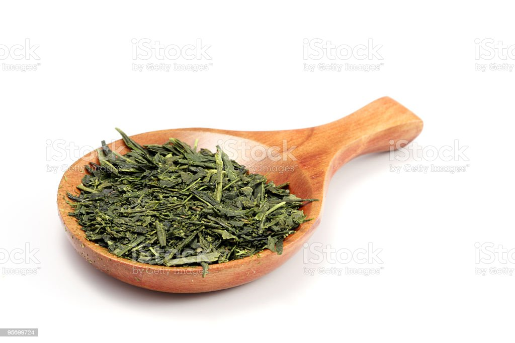Green tea and wooden spoon royalty-free stock photo