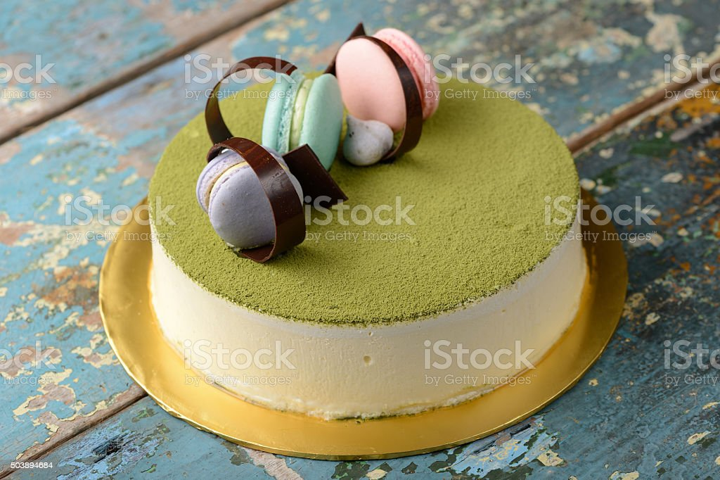 Green tea cheese cake with macaroon stock photo