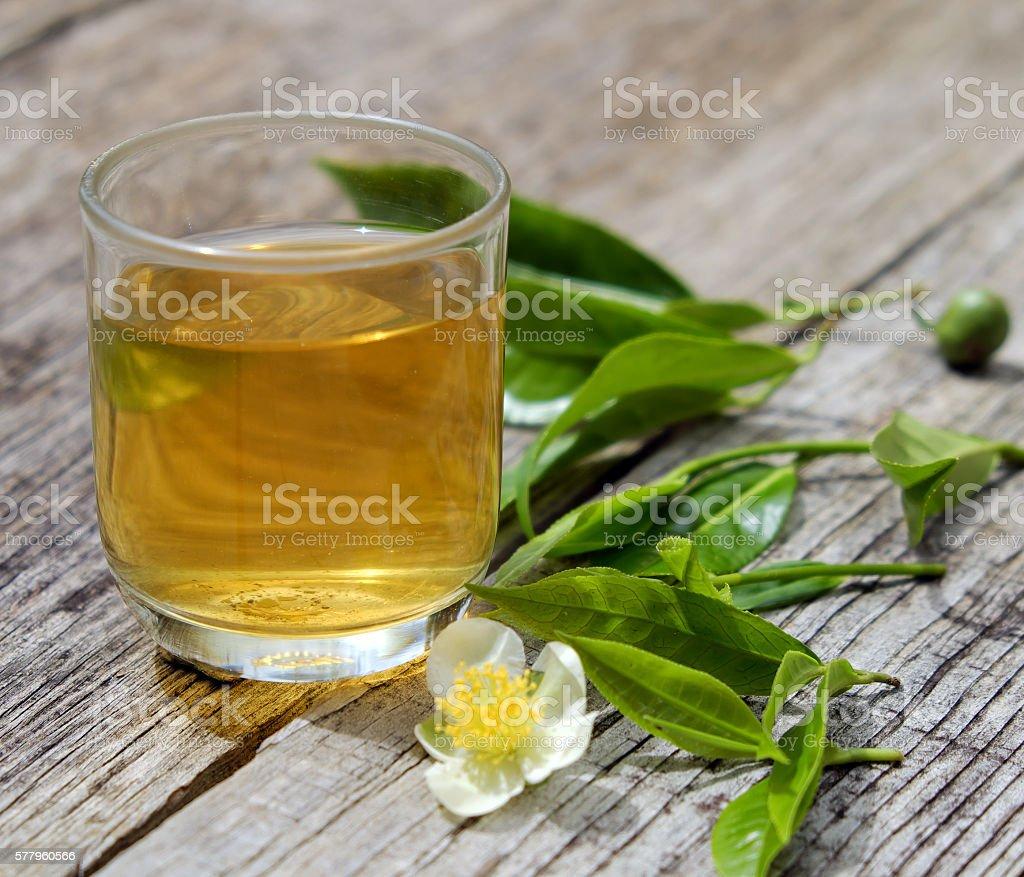 Green tea cup, tea leaf stock photo