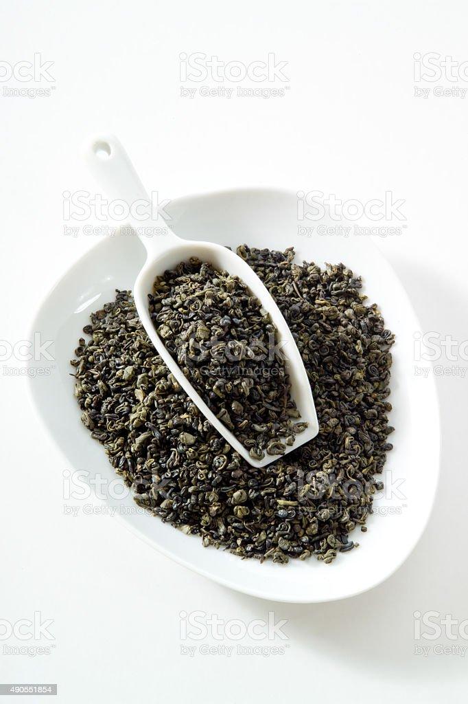 Green tea, gunpowder tea, bowl, white background stock photo