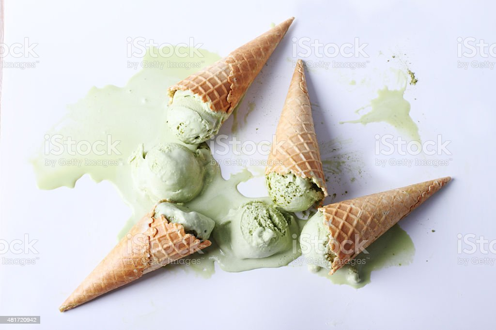 green tea ice cream cones dropped stock photo
