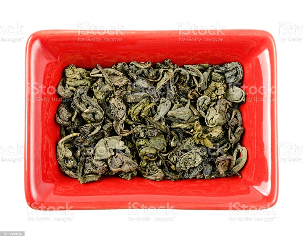 green tea in a bowl. Isolated stock photo