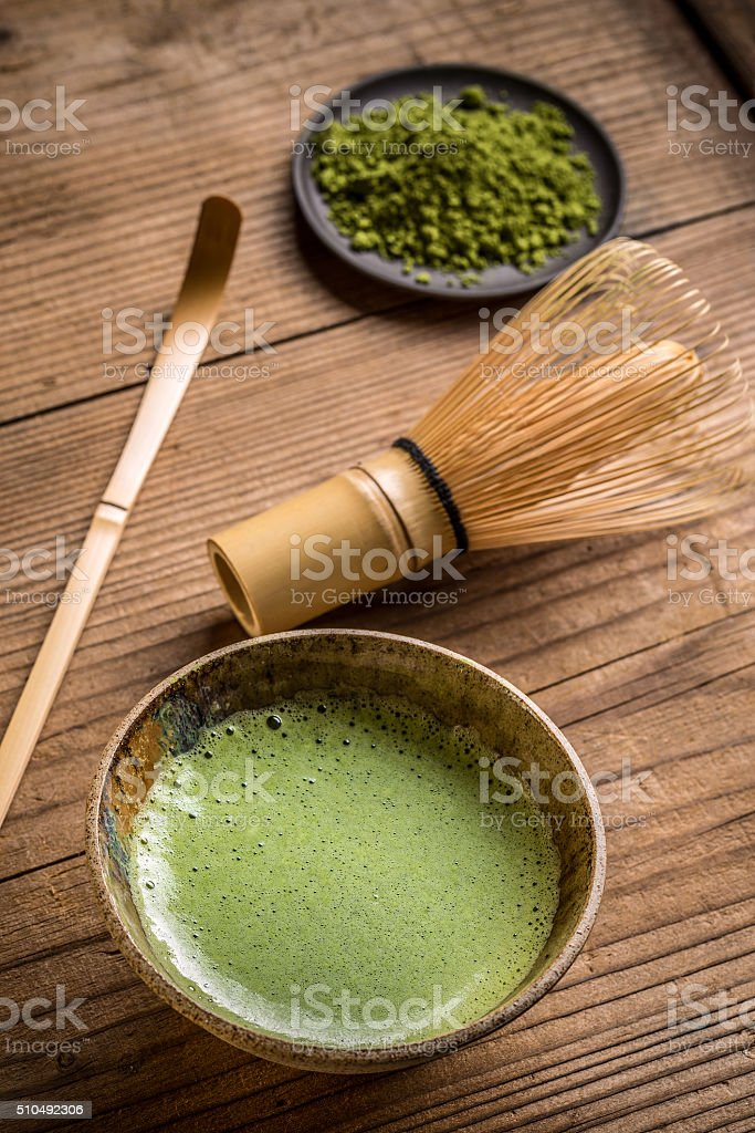 Green tea in bowl stock photo
